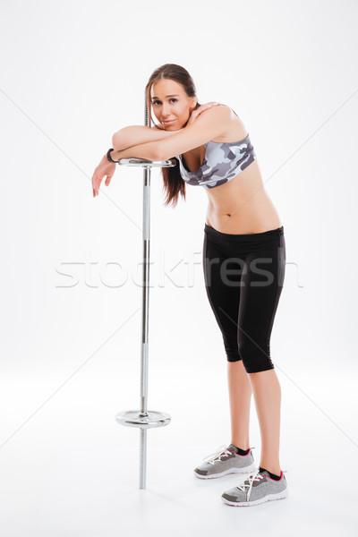 Joli fitness fille barbell isolé Photo stock © deandrobot