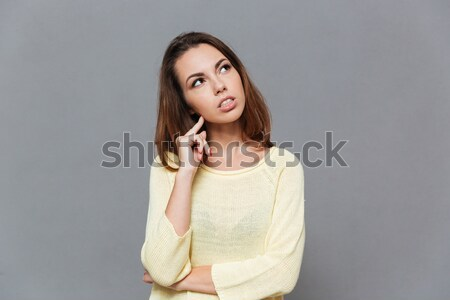 Portrait of a casual girl showing silence gesture with finger Stock photo © deandrobot