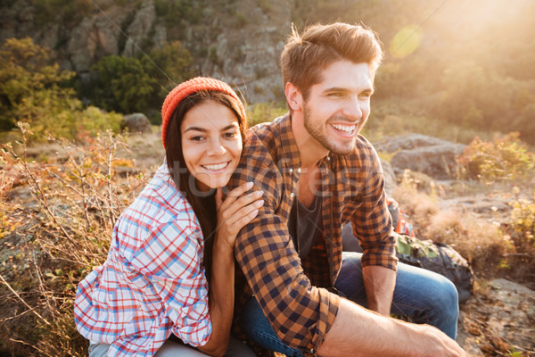 Hiking couple. Young active couple having fun outdoors in valley. Stock photo © deandrobot