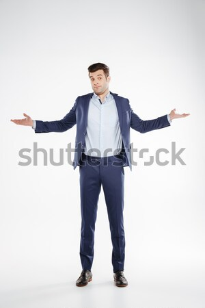 Vertical image of happy man showing thumbs up Stock photo © deandrobot