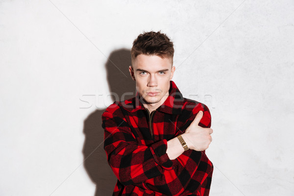 Hipster in shirt with crossed arms Stock photo © deandrobot