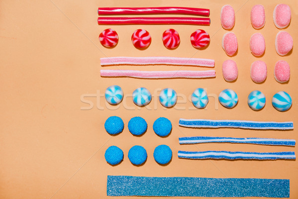 Top view of a colorful sweet sugar candies in a row Stock photo © deandrobot