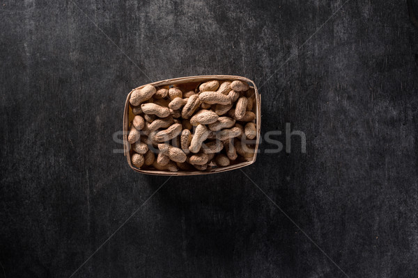 Top view photo of dried peanuts Stock photo © deandrobot