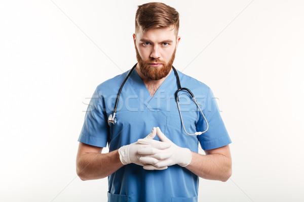Retrato sério concentrado masculino médico médico Foto stock © deandrobot