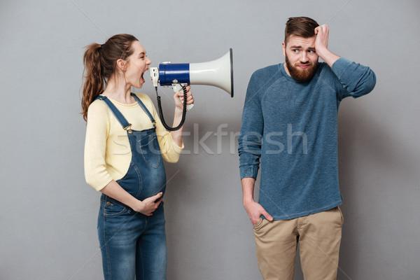 Grávida gritando mulher alto-falante confuso Foto stock © deandrobot