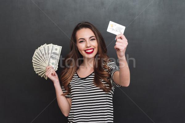 Mosolyog fiatal hölgy tart pénz debitkártya Stock fotó © deandrobot