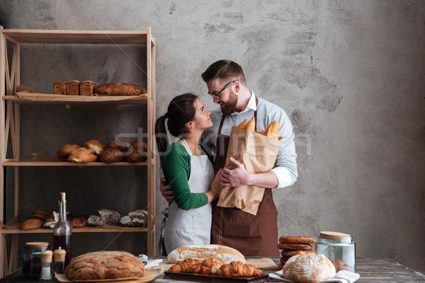 Feliz amoroso casal pão mãos Foto stock © deandrobot