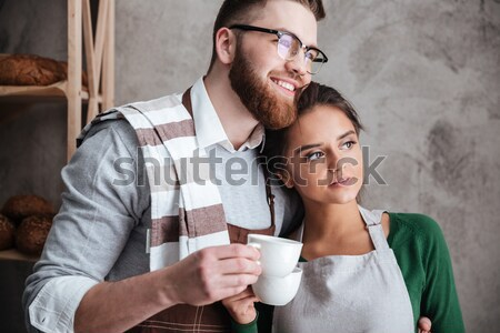 Loving couple bakers drinking coffee Stock photo © deandrobot