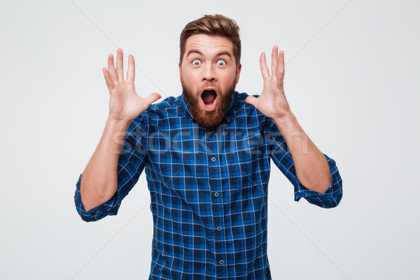 Screaming shocked man looking camera isolated Stock photo © deandrobot
