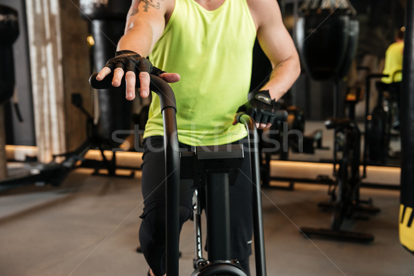 Cropped image of a sportsman on a treadmill Stock photo © deandrobot