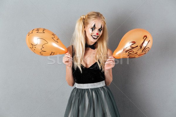 Gek blonde vrouw clown make halloween Stockfoto © deandrobot