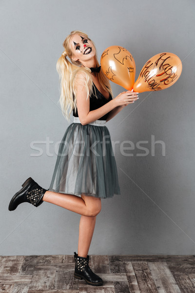 Image heureux femme blonde halloween composent Photo stock © deandrobot