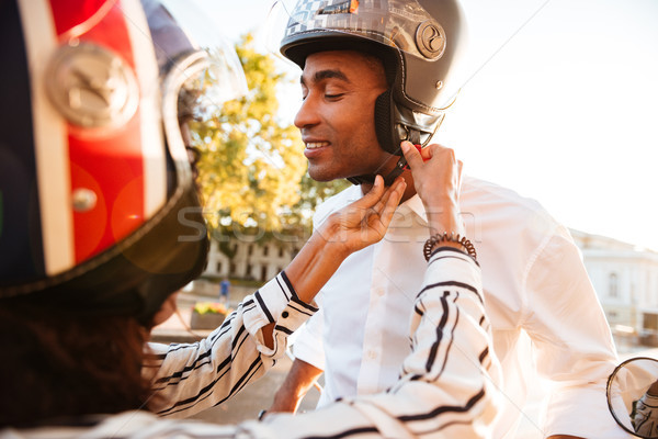 Young attractive african couple in moto halmets Stock photo © deandrobot