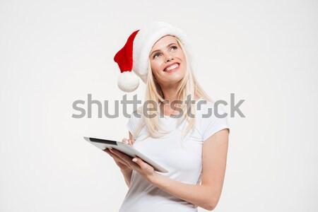 Portré töprengő mosolygó nő karácsony kalap tart Stock fotó © deandrobot