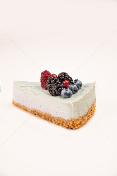 Shot of blue cheesecake with different berries Stock photo © deandrobot