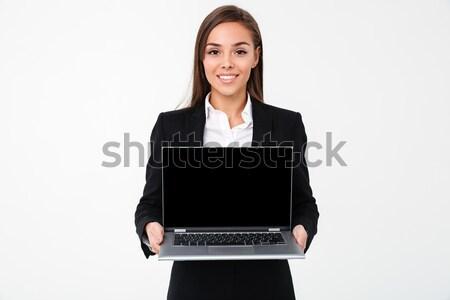 Alegre bastante empresária exibir computador portátil Foto stock © deandrobot