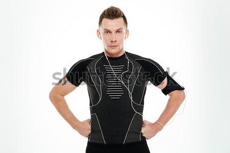 Portré fitt fiatal sportoló zenét hallgat fejhallgató Stock fotó © deandrobot