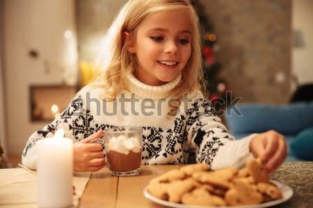 Küçük kız içme kakao Stok fotoğraf © deandrobot