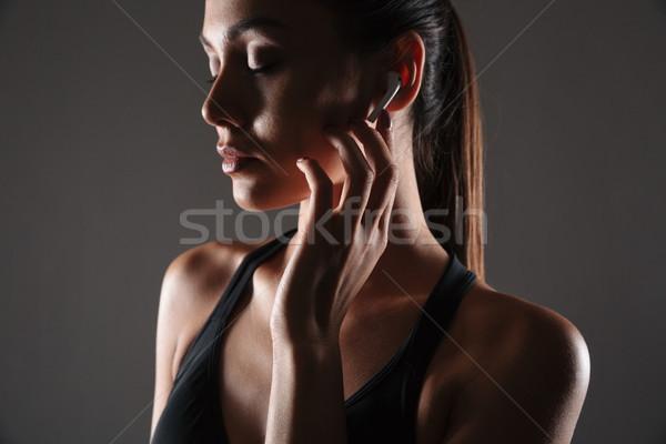肖像 小さな フィットネス女性 イヤホン かなり ストックフォト © deandrobot