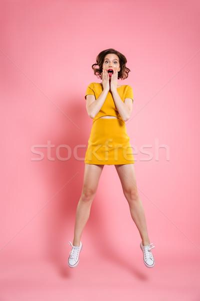 Retrato atraente maravilhado mulher jovem tocante Foto stock © deandrobot