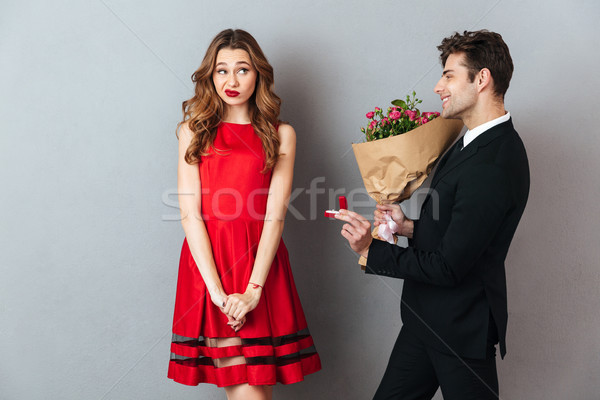 Portrait of a smiling man proposing to a girl Stock photo © deandrobot