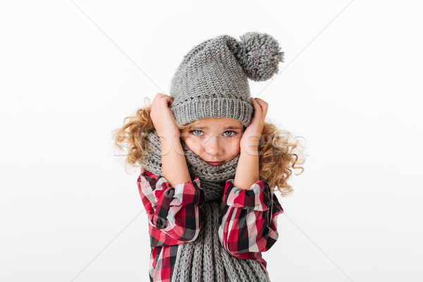 Portrait of a frozen little girl dressed in winter hat Stock photo © deandrobot