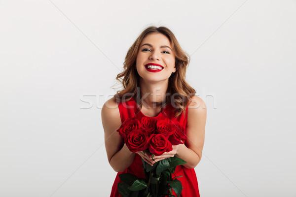 肖像 満足した 若い女性 赤いドレス 花束 ストックフォト © deandrobot
