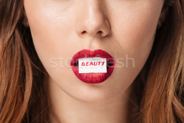 Close up portrait of a relaxed brown haired woman Stock photo © deandrobot