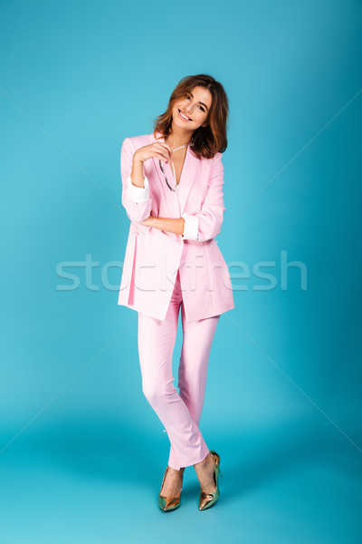 Full length portrait of a smiling woman dressed in suit Stock photo © deandrobot