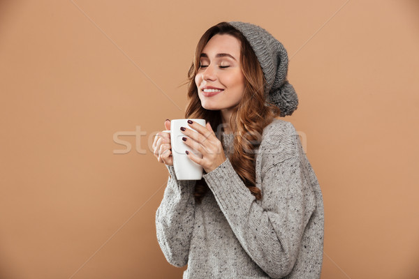 Portrait of cheerful caucasian woman with closed eyes holding bi Stock photo © deandrobot