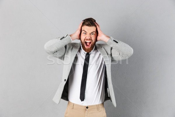 Stock photo: Portrait of an angry businessman dressed in suit