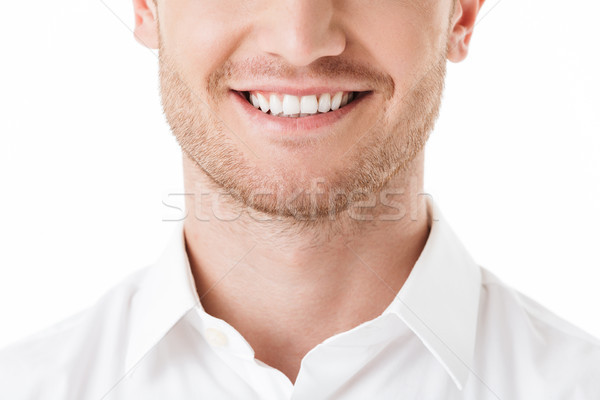 Close up of happy man's toothy smile Stock photo © deandrobot