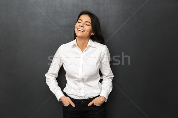 Image of businesslike cheerful woman wearing formal outfit smili Stock photo © deandrobot