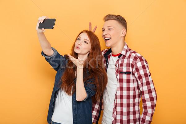 Portrait ravi adolescent couple téléphone portable Photo stock © deandrobot