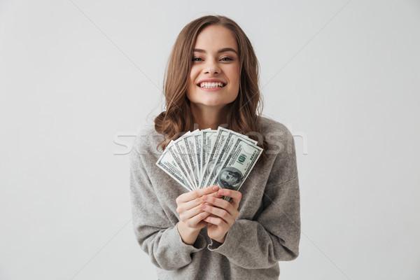 Alegre morena mujer suéter dinero Foto stock © deandrobot