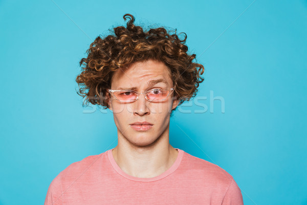 Ritratto confusi uomo guardando fotocamera Foto d'archivio © deandrobot
