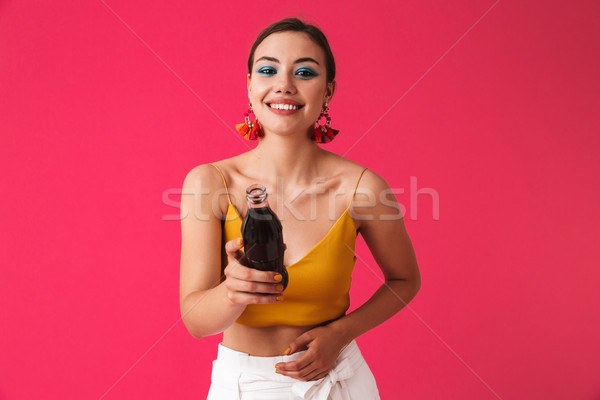 Cheerful young girl with bright make-up Stock photo © deandrobot