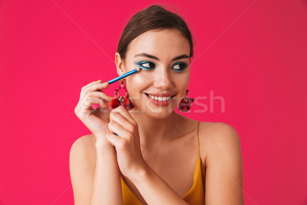 Portrait of gorgeous stylish woman 20s wearing earrings smiling  Stock photo © deandrobot