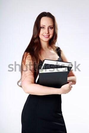 Felice donna piedi libri grigio Foto d'archivio © deandrobot