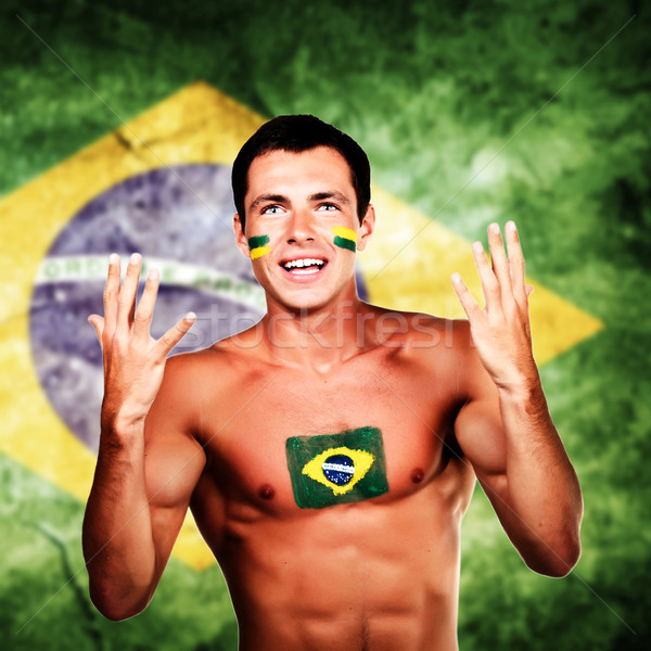Happy brazilian fan over brazil flag background Stock photo © deandrobot