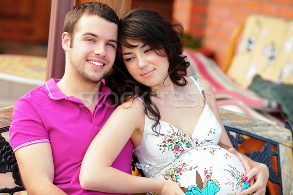 Joven embarazadas esposa aire libre sonrisa nino Foto stock © deandrobot