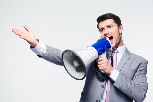 ビジネスマン 悲鳴 ラウドスピーカー ハンサム グレー 背景 ストックフォト © deandrobot