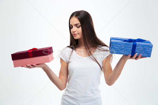 Woman making choice between two gift boxes  Stock photo © deandrobot