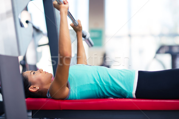 Beautiful woman work out with barbell Stock photo © deandrobot
