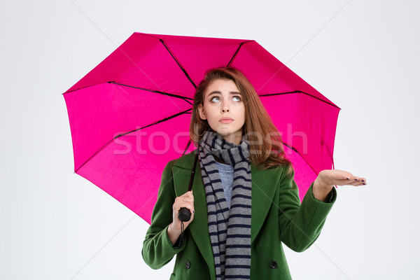 Woman in coat and scarf holding umbrella Stock photo © deandrobot