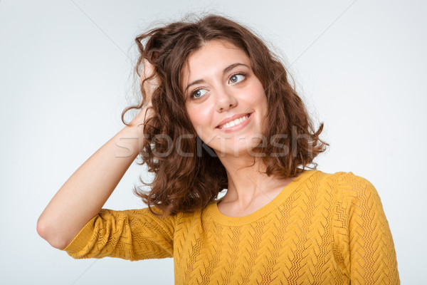 Happy thoughtful woman looking away  Stock photo © deandrobot