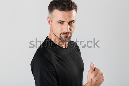 Scared dazed handsome young man with beard in sweetshirt  Stock photo © deandrobot