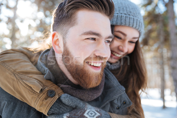 Couple having fun in winter park Stock photo © deandrobot