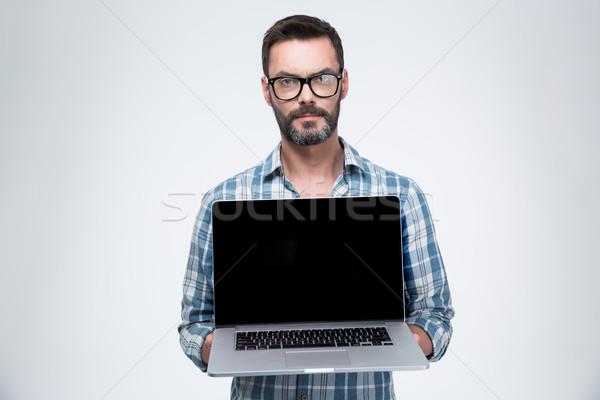 Homem computador portátil tela homem bonito isolado Foto stock © deandrobot