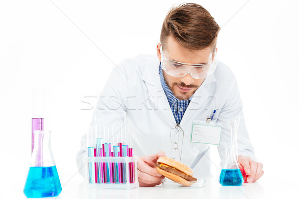 Male chemist making GMOs food Stock photo © deandrobot